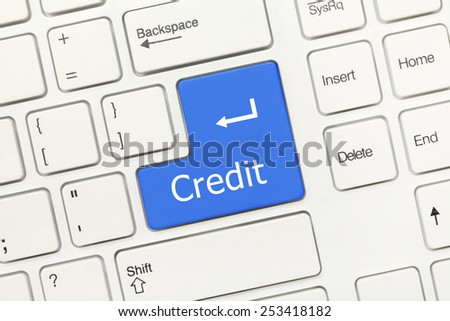Close-up view on white conceptual keyboard - Credit (blue key)