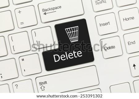Close-up view on white conceptual keyboard - Delete (black key) - stock photo