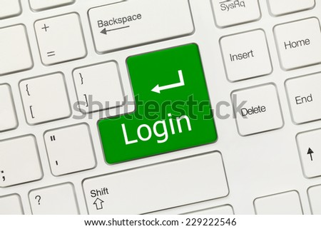 Close-up view on white conceptual keyboard - Login (green key)