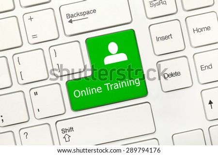 Close-up view on white conceptual keyboard - Online training (green key) - stock photo