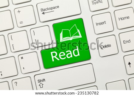 Close-up view on white conceptual keyboard - Read (green key) - stock photo