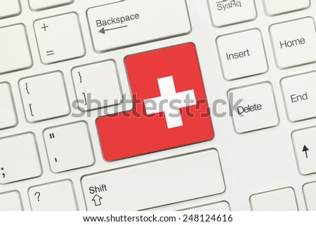 Close-up view on white conceptual keyboard - Switzerland (key with flag)