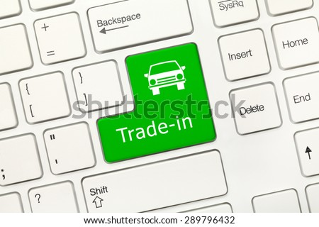 Close-up view on white conceptual keyboard - Trade-in (green key) - stock photo