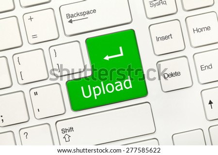 Close-up view on white conceptual keyboard - Upload (green key) - stock photo