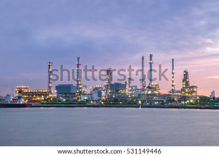 Close up view Refinery tower in petrochemical industrial plant with cloudy sky at the Chaophaya river in Bangkok Thailand