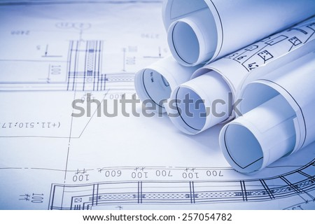 close up view stack of white construction blueprints with copyspace for your text  - stock photo
