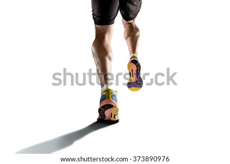 close up view strong athletic legs with ripped calf muscle of young sport man running isolated on white background with copy space in sport fitness endurance and high performance concept - stock photo