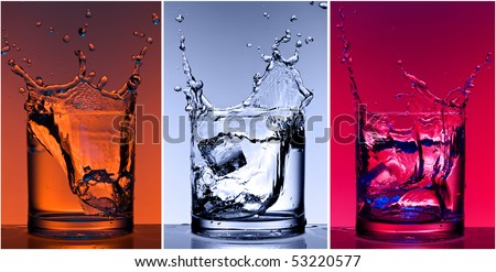 Close-up views of the splash in water with different colour lighting - stock photo
