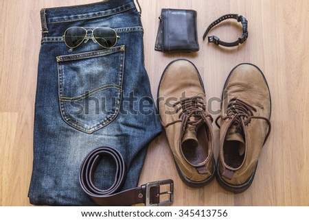 Close up vintage clothing with jeans and boots - stock photo