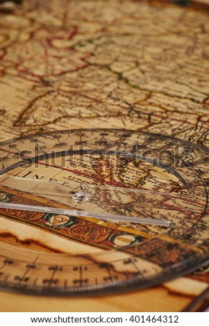 close up Vintage map with and scale in warm tone lighting - stock photo