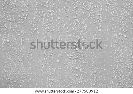 Close up water drop on gray background. - stock photo