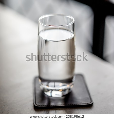 close up water in glass on dining table - stock photo