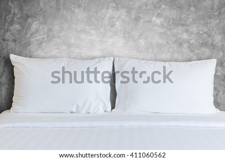 Close up white bedding sheets and pillow in hotel room