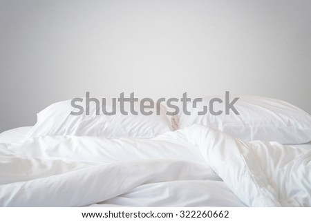white bed sheets background. Close Up White Bedding Sheets And Pillow On Natural Stone Wall Room Background, Messy Bed Background S