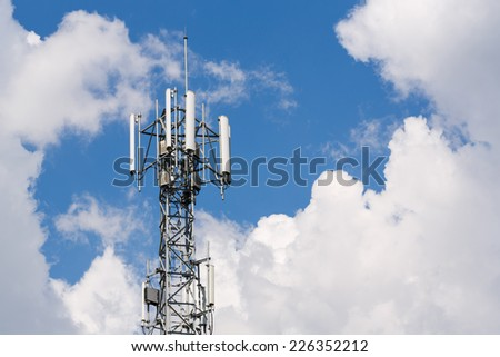 Close up white color antenna repeater tower on blue sky - stock photo