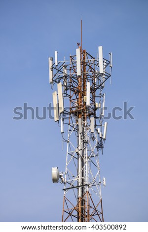 Close up white color antenna repeater tower on blue sky.