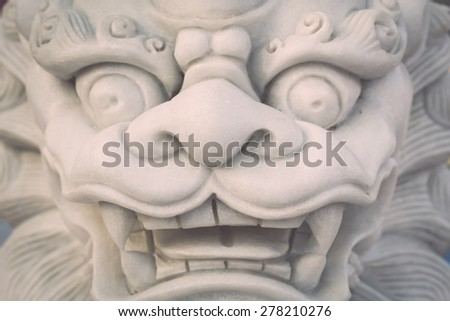 Close up white marble lion statue stand in Chinese temple, Thailand
