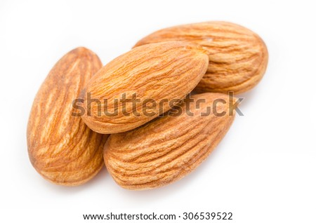 Close up Whole almonds on a white background. - stock photo