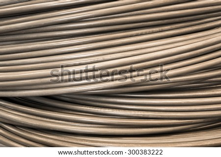 Close up wire coil metal material texture for industrial background