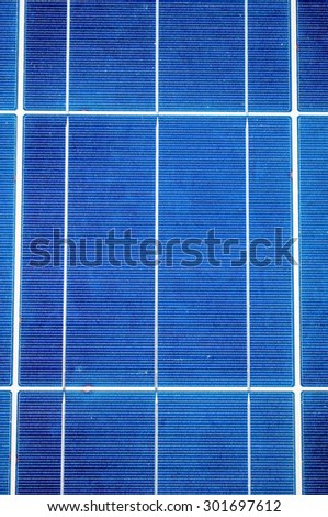 Close-up with blue solar panel cells as renewable energy concept - stock photo