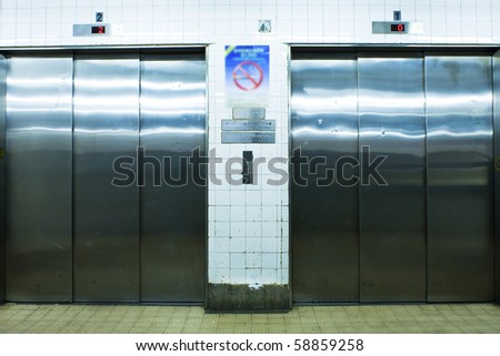 close up with two elevator in hong kong - stock photo