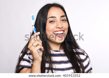 Close-up woman brushing her teeth. Isolated white background. - stock photo