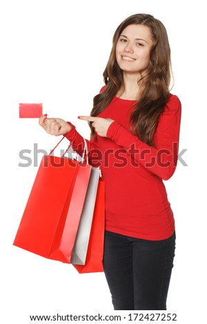 Close up woman hand with many shopping bags and credit card. - stock photo