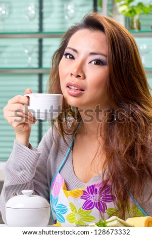 Close up woman hold coffee cup in breakfast in the morning - stock photo