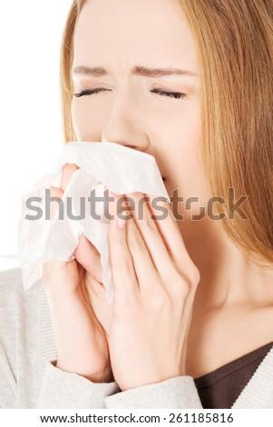 Close up woman holding tissue sneezing. - stock photo