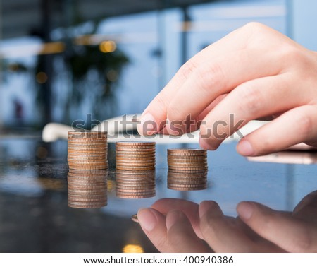 close up - woman put coins to stack of coins