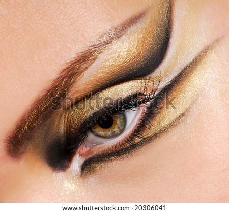Close-up woman's eye with multicolored stylish make-up - stock photo