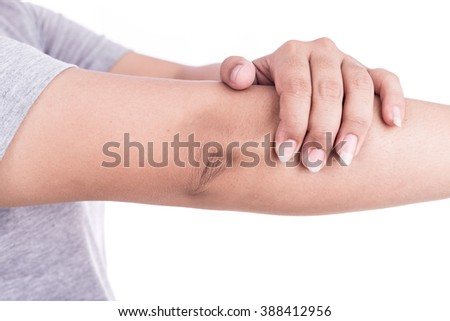 Close up woman's hand holding her elbow isolated on white background. Elbow pain concept. - stock photo