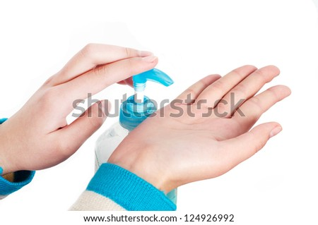 Close-up woman's hand using hand sanitizer