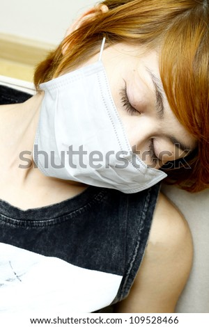 close-up woman sleep and wearing protective mask - stock photo