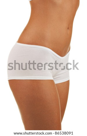 Close up woman slim body in white lingerie against white background - stock photo