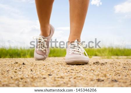 Close Up Woman Walking Outdoors - stock photo