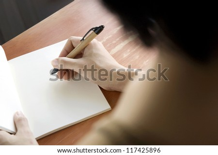 close up woman writing on notebook - stock photo