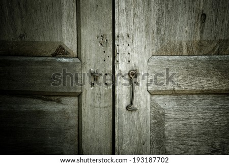 close up wooden doors, vintage traditional old doors with wooden wall