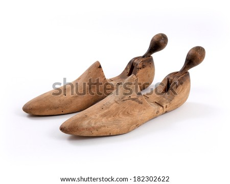 Close up wooden shoe stretcher isolated on white background - stock photo