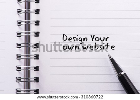 Close up word written design your own website on notebook - stock photo