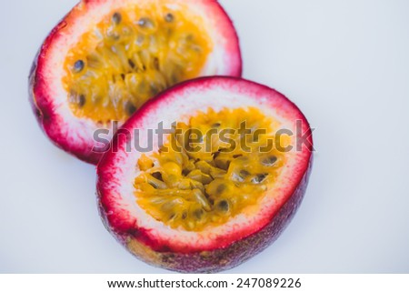 Close up yellow color passion fruit maracuya  pulp and seed in small ceramic bowl isolated on white - stock photo