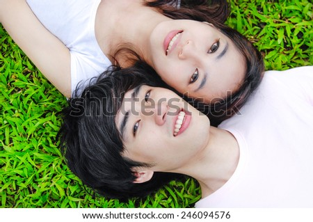 Close up young couple in love outdoors - stock photo