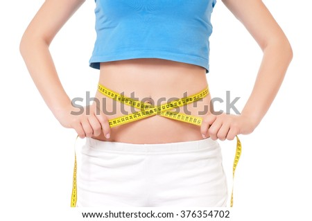 Close up young fitness model with measuring tape  - stock photo