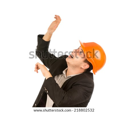 Close up Young Middle Age Engineer in Black Coat and Orange Head Protector Looking Up. Isolated on White Background. - stock photo