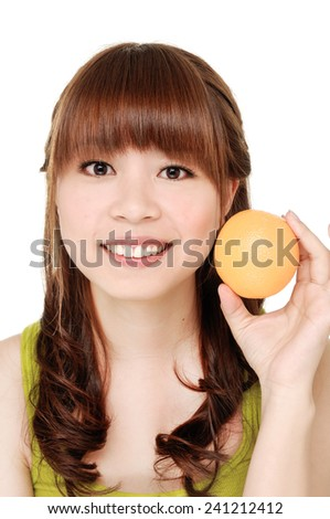 Close up young smiling woman showing tropical fruit - stock photo