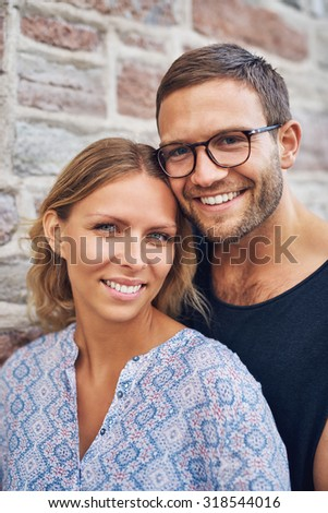 Close up Young Sweet Couple Looking at the Camera with Toothy Smile.