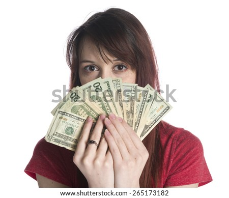 Close up Young Woman Covering Half of her Face with a Fan of 20 US Dollar Paper Bills While Looking at the Camera. Isolated on White Background. - stock photo