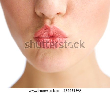 Close up young woman half face kissing lips - stock photo