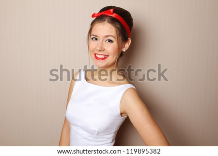 Close-up young woman in the style of 60s. White dress, red lips