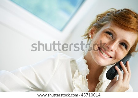 close-up young woman talking  phone - stock photo
